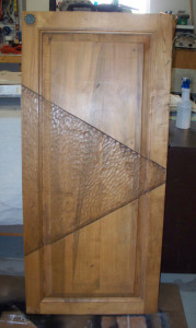 Heavy wood cabinet door with unique triangular carving.