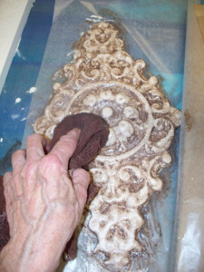 Brush glaze then wipe off the excess to bring out the detail of cast plaster.
